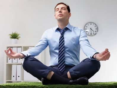Business worker meditating at work