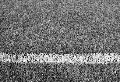 Close_up_of_soccer_fields_barrier_line