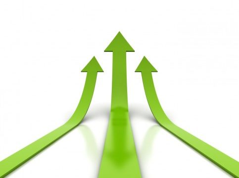Green arrows moving forwards and upwards - graphic