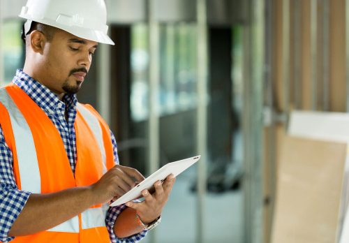 Construction worker using a digital tablet