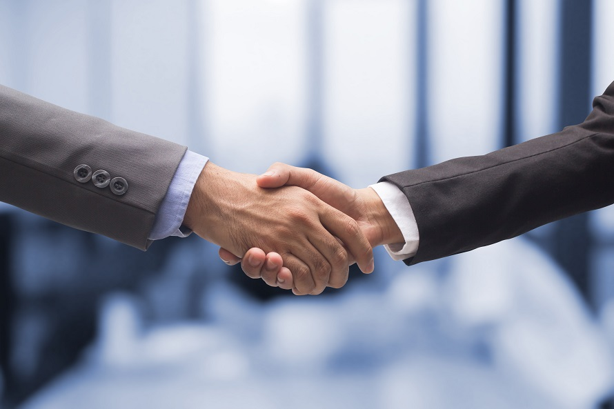 Handshake between two business workers