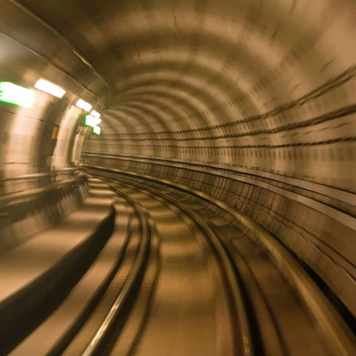 Fast moving through a railway tunnel, blurred from speed movement